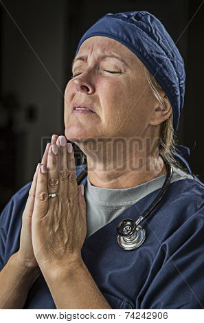 Pleading with Hands in Prayer Female Doctor or Nurse.