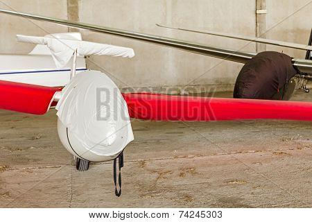 Lightweight Gliders Stationed Inside Of A Big Hangar