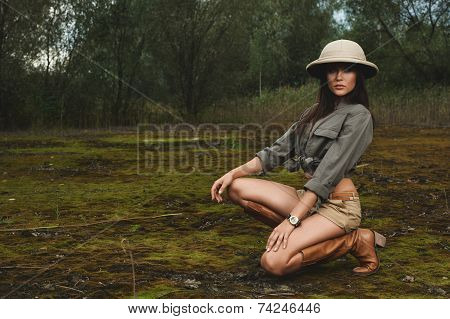 safari woman in  the morning swamp