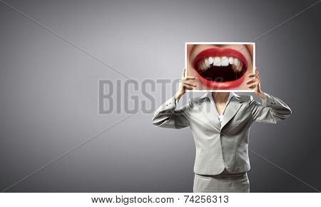 Unrecognizable businesswoman holding big photo with lips