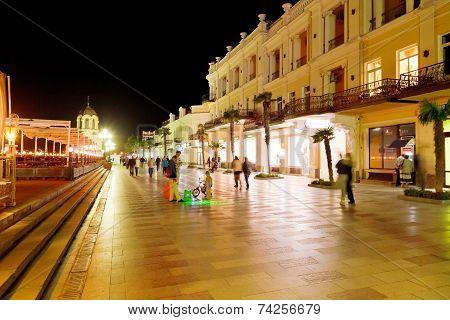 People Walking On Promenade In Yalta City In Night