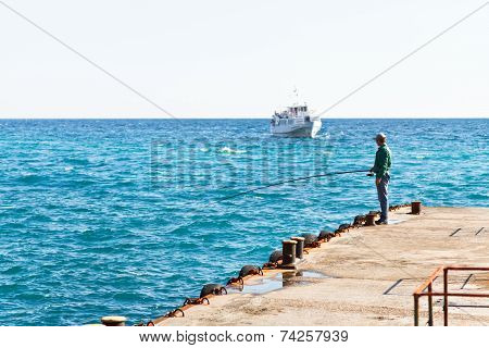 Fisherman On Pier In Black Sea