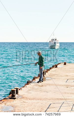 Fisherman Fish From Pier In Black Sea