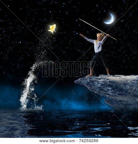 Cute girl fisherman throwing harpoon to catch gold fish