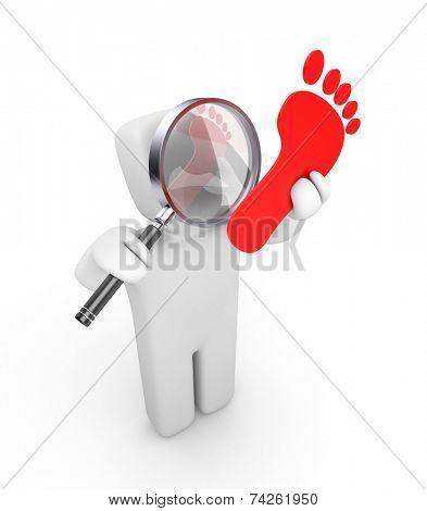 Person examines footprint