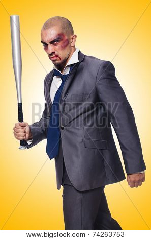 Badly bruised businessman with bat on white