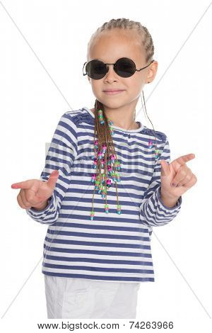 Cute little girl showing thumbs up in different directions. Girl is six years old.