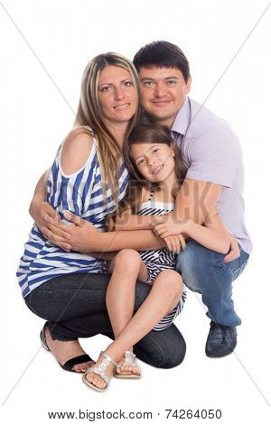 Portrait of parents and daughter crouching. Isolated on white.