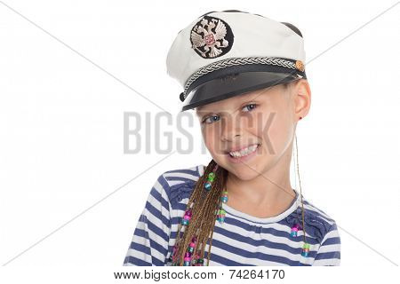 Happy little girl six years old in a suit cabin boy. Girl is six years old. On her cap emblem of Russia.
