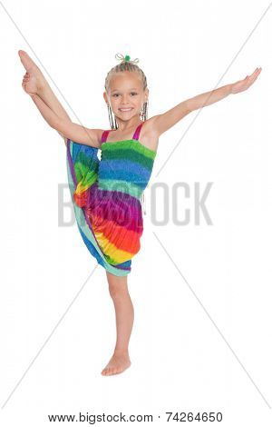 Cute girl doing exercise vertical split. Girl is six years old.