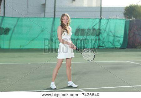 Beautiful Blonde Woman Playing Tennis