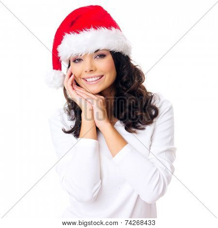 Young woman with a gorgeous warm happy smile in a festive red Santa Hat as she celebrates Christmas  isolated on white