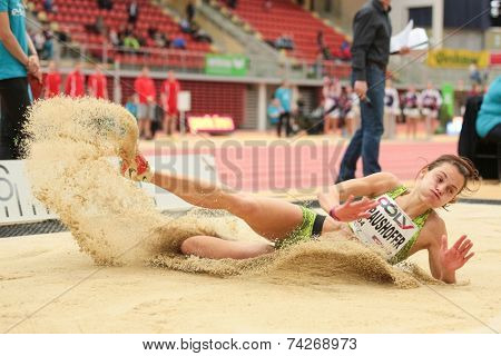 LINZ, AUSTRIA - JANUARY 30, 2014: Marina Kraushofer (#604 Austria) places 6th in the long jump team event in an indoor track and field meeting.