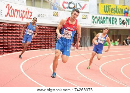 LINZ, AUSTRIA - JANUARY 30, 2014: Zvonimir Ivaskovic (#225 Croatia) places 3rd in the men's 200m event in an indoor track and field meeting.