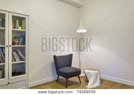 Grey upholstered chair in living room