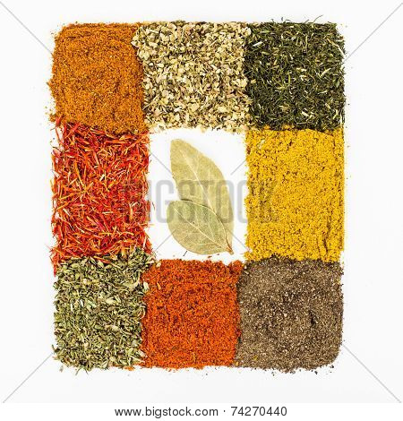 Spices Macro Decorated As Frame With Bay Leaf Inside Isolated On White