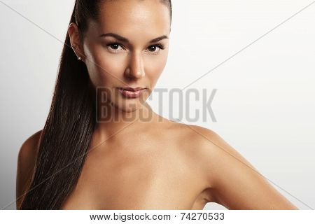 Closeup Portrait Of A Beauty Woman With A Ponytail