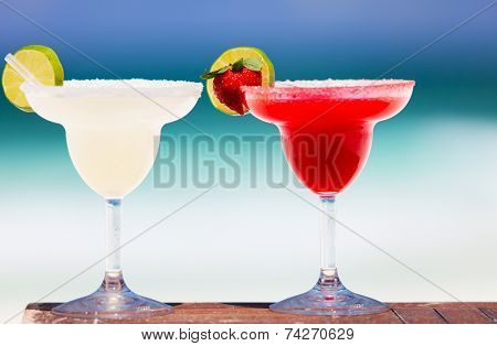 Classic and strawberry margarita cocktails at exotic Mexican beach