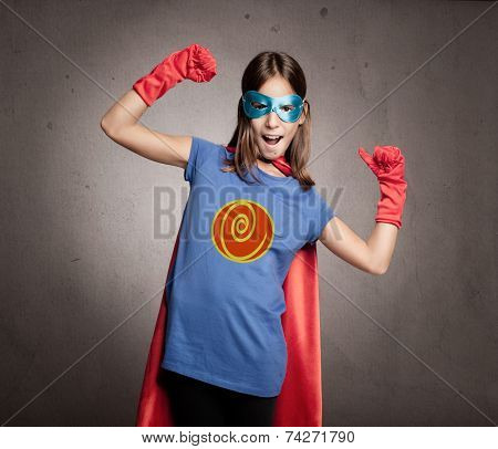 little girl wearing a superhero costume