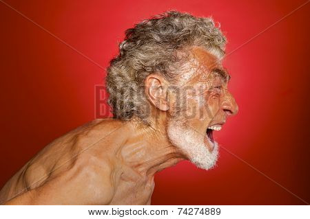 Portrait Of A Screaming Man On Red Background