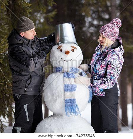 Couple Makes Snowman