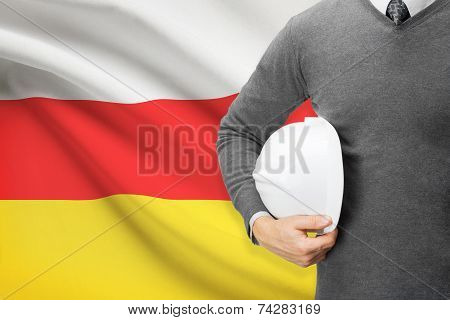 Engineer With Flag On Background - South Ossetia