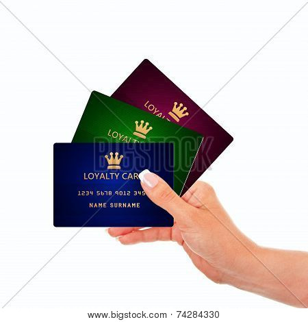 Hand Holding Loyalty Cards Isolated Over White