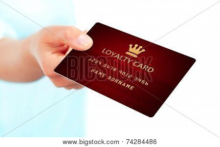 Hand Holding Loyalty Card Isolated Over White