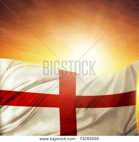 English flag in front of bright sky