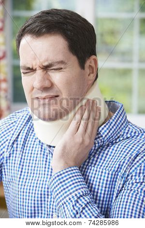 Man Wearing Surgical Collar In Pain
