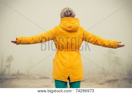Young Woman with raised hands enjoying outdoor Travel