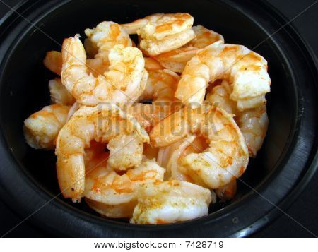 Cooked shrimp in black bowl