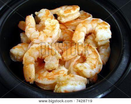 Cooked shrimp in black bowl