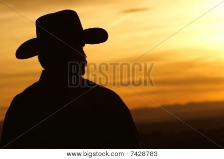 Cowboy Silhouette and Bright Sunset