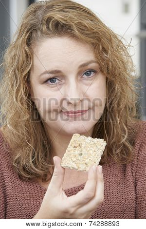 Bored Woman On Diet Eating Crispbread At Home