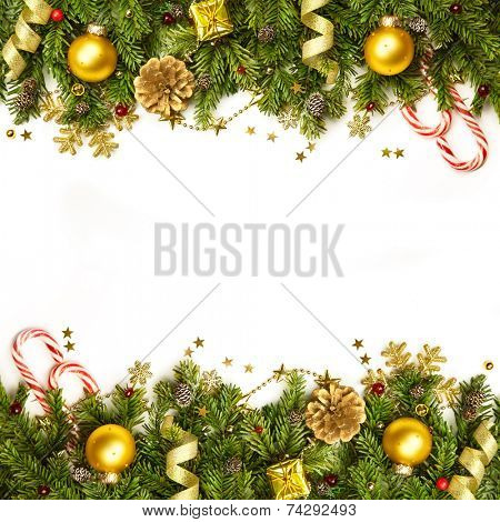Christmas tree branches with golden baubles, stars, snowflakes -  border isolated on white - horizontal