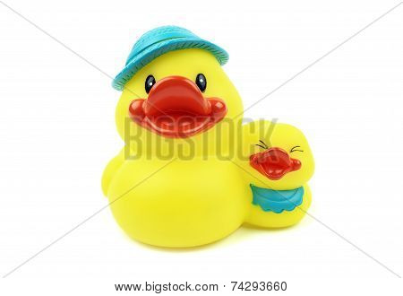 Ducks On White Background. Yellow Rubber Toy.