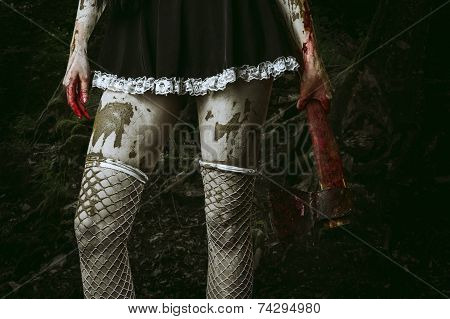 Dirty Woman's Hand Holding A Bloody Ax