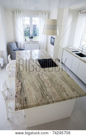 Big Granitic Worktop In Bright Kitchen