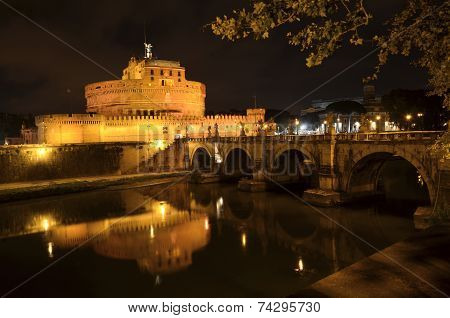 Majestic Castle of Saint Angel over the Tiber river by night  in Rome, Italy