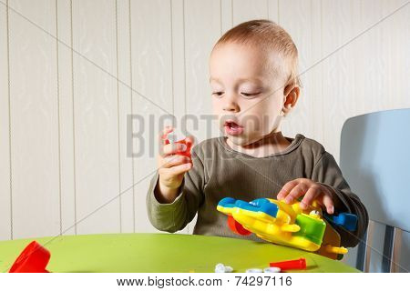 little boy repairs auto