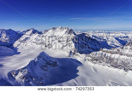 Mountain Peaks Chain In Jungfrau Region Helicopter View In Winter
