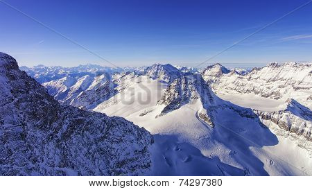 Peaks Chain Skyline And Valley In Jungfrau Region Helicopter View In Winter