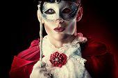 stock photo of dracula  - Handsome vampire wearing venetian mask - JPG