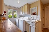 pic of laundry  - Laundry room with window and standard appliances - JPG