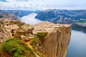 stock photo of cliffs  - Cliff Preikestolen in fjord Lysefjord  - JPG