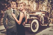 picture of mafia  - Beautiful retro couple against vintage car - JPG