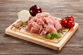 picture of turkey-hen  - Raw turkey meat on cutting board on wooden background - JPG