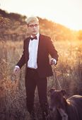 picture of greyhounds  - Young attractive man in suit and tie with a greyhound dog in autumn outdoors - JPG