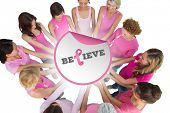 foto of  breasts  - Cheerful women joined in a circle and looking at each otherwearing pink for breast cancer against breast cancer awareness message - JPG